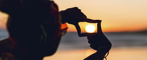 hand-frame-sunset
