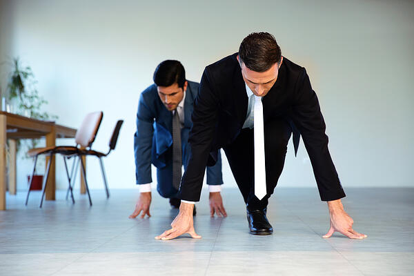 Two businessmen getting ready for corporate race - rat race concept-1