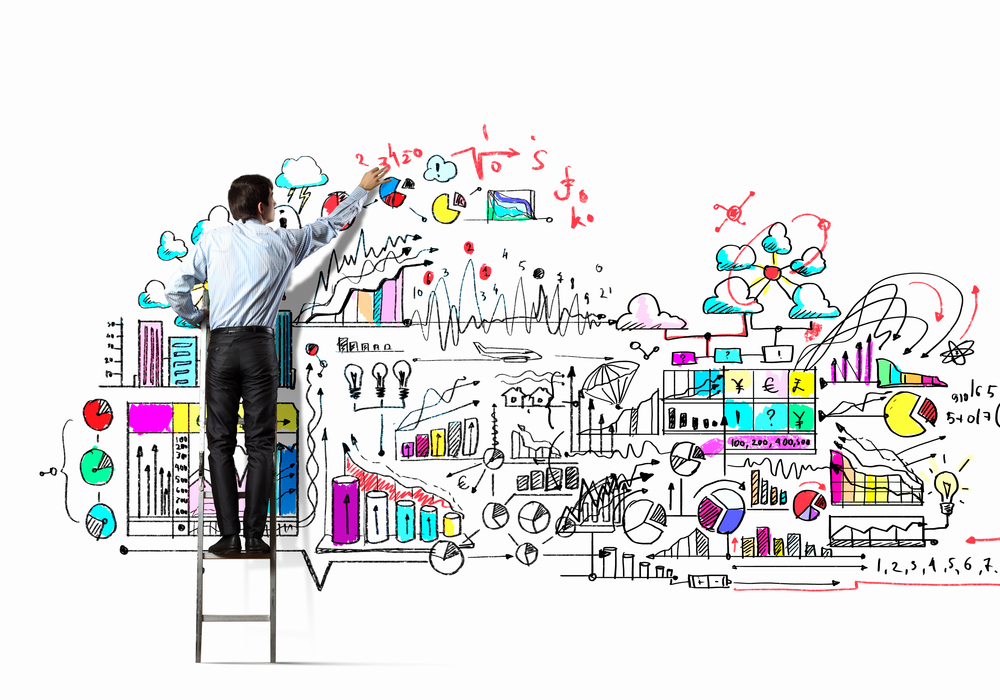 Back view of businessman drawing sketch on wall-1